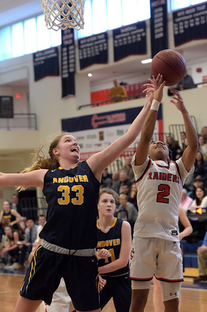 TIM JEAN/Staff photo <br /> <br /> Andover's Anna Foley, left, fights for the rebound against Central's Nadeshka Bridgewater during girls basketball Division 1 North quarterfinals.    2/29/20