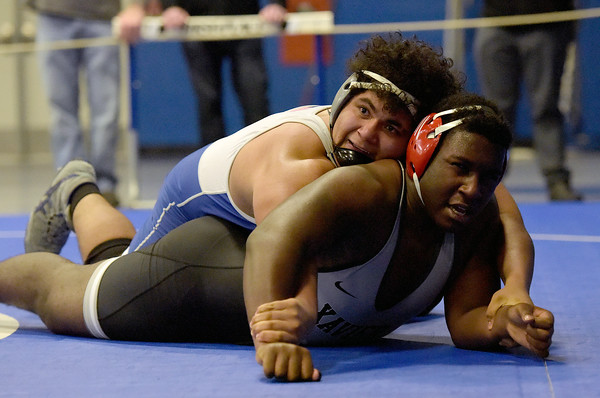 TIM JEAN/Staff photo <br /> <br /> Salem's Josh Ozoria, top, looks up after taking down Xavier Ct., Malcolm Wilson in the 285 pound match during the Methuen Invitational.  Ozoria won 5-4 for 3rd in the finals.   2/1/20