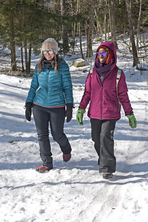 TIM JEAN/Staff photo <br /> <br /> Jocelyn Demas, left, member of Londonderry Conservation Committee and Val Ward, of Londonderry walk along the Landing Trail during the Annual Musquash Field Day in Londonderry, NH.  2/15/20