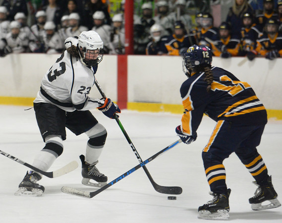 CARL RUSSO/Staff photo HPNA'S Resse Pascucci moves the puck against Andover's Vanessa Pierni. HPNA (Haverhill, Pentucket, North Andover) defeated Andover 4-2 in girls' hockey action. 2/19/2020.