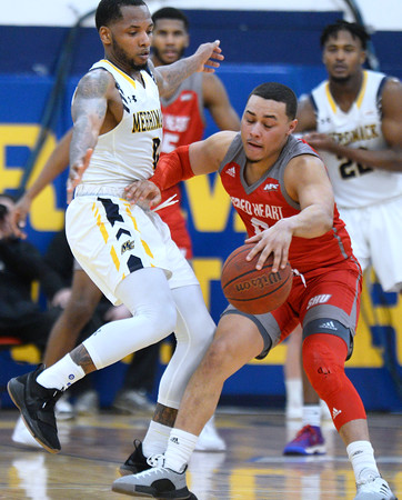 CARL RUSSO/Staff photo. Merrimack's Juvaris Hayes plays tight defense  against Sacred Heart's Aaron Clarke. Merrimack College defeated Sacred Heart 64-57 in men's basketball action. 2/21/2020