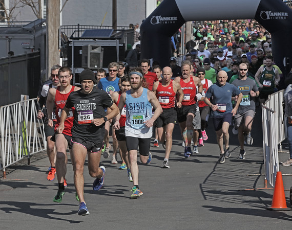 MIKE SPRINGER/Staff photo<br /> Race winner Robert DeSiste Jr. of Cambridge (number 626) takes an early lead at the start of the 13th annual Frozen Shamrock Road Race on Sunday in downtown Haverhill.<br /> 1/23/2020