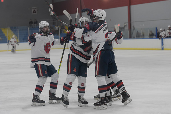 TIM JEAN/Staff photo <br /> Central's Andrew Flammia, center, celebrates scoring a goal against Andover during a boys hockey game at the ICenter in Salem NH.     2/8/20