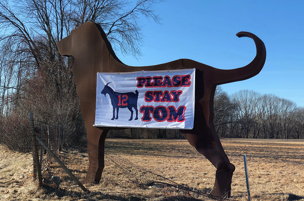 Courtesy Photo<br /> <br /> Metal sculptor Dale Rogers, of Haverhill, has hung a banner one of his 16-foot tall American Dog sculpture on Route 495 South at the exit 48 off ramp that reads Please Stay Tom.   1/30/20