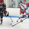 CARL RUSSO/Staff photo North Andover's Adam Heinze slaps the puck surrounded by Tewksbury defenders. North Andover defeated Tewksbury 3-2 in Div. 2 hockey quarterfinals at the Chelmsford Forum Friday night. 2/28/2020