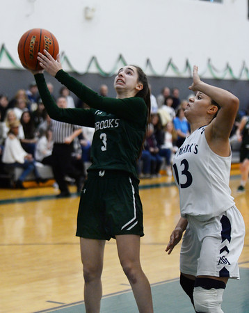 CARL RUSSO/Staff Photo. On February 26, Brooks School defeated St. Mark's 81-25 in girls basketball action during senior night. Emma Riley of Lynnfield drives to the hoop. 2/26/2020.