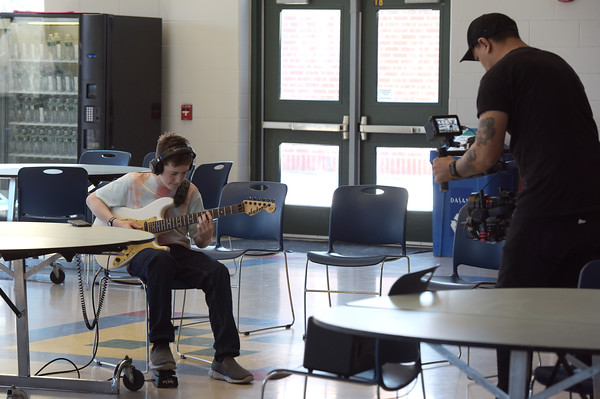 "TIM JEAN/Staff photo <br /> <br /> Hood Middle School student James MacDonald, left, plays his guitar while being filmed for a video for  ""Unforgettable.""      2/14/20"