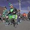 MIKE SPRINGER/Staff photo<br /> Runners set out from the starting line of the 13th annual Frozen Shamrock Road Race on Sunday in downtown Haverhill.<br /> 1/23/2020