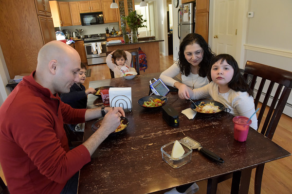 TIM JEAN/Staff photo <br /> <br /> Kyki receives help from her mother Panayiota to eat as the whole family sits together for lunch. Seated from left are John Anastasiadis, his son Kosta, 5, daughter Antigone, 2, his wife Panayiota, and Kyki, 7.   2/21/20