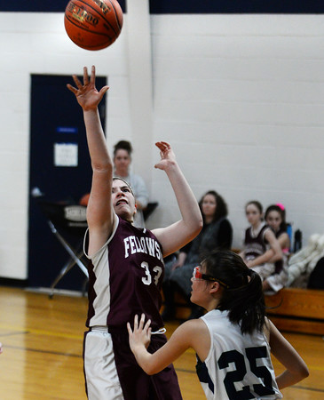 CARL RUSSO/Staff photo Fellowship's Ester Mills takes the jump shot over and PMA's Connie Chong. Presentation of Mary Academy defeated Fellowship Christian Academy 51-43 in girls' basketball action Tuesday afternoon. 2/04/2020