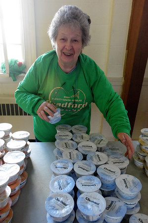 TIM JEAN/Staff photo <br /> <br /> <br /> Volunteer Janet Charette, of Kingston, NH., stacks up blueberry yogurt for the runners after the race during the annual Bradford Valentine Road Race. Finishers received a small box of chocolates, commemorative medal, and a Valentines flower.  2/8/20