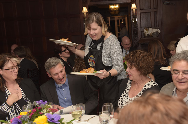 TIM JEAN/Staff photo <br /> <br /> Andover Select Board Chairwoman Laura Gregory serves dinner as a Superstar Server and during the Andover Cares fundraiser at the LANAM club in Andover. 2/27/20