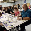 TIM JEAN/Staff photo <br /> <br /> Paul Zannoni, right paints  tiles with his children Katelynn, and Victor, left, during a tiles and tours night at Pelham Memorial School, organized by Pelham ACES. The tiles will be installed near the school entrance as a public art project for generation to see. Voters will be asked to pay for renovations at Town Meeting Day on March 10th.     2/12/20
