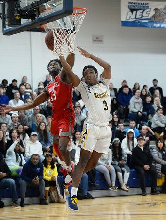 CARL RUSSO/Staff photo. Merrimack's Mykel Derring is fouled on a break away to the basket by Sacred Heart's Chaylyn Martin. Merrimack College defeated Sacred Heart 64-57 in men's basketball action. 2/21/2020.
