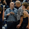 CARL RUSSO/Staff Photo. Andover head coach, David Fazio talks to one of the officials. Officials had to keep the peace with the coaches early in the game. Lawrence defeated Andover 60-54 in boys Basketball action in the D1 North tournament. 2/25/2020.