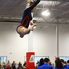 CARL RUSSO/Staff photo Central Catholic's senior captain, Meagan Kelly leaps into the air as she competes on the beam.<br /> <br /> The Merrimack Valley Conference Gymnastic League Meet was held Thursday night, February 6, at A2 Gym and Cheer in Salem NH. 2/6/2020.