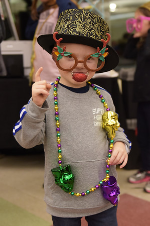 """TIM JEAN/Staff photo <br /> <br /> Abbott Webb, 4, plays with the selfi station assessors from DJ Sharon """"Simple The Best"""" in Derry, during the 15th annual Potter's Bowl fundraiser to benefit Community Caregivers of Greater Derry. The event was held at Pinkerton Academy in Derry, NH.     2/1/20"""