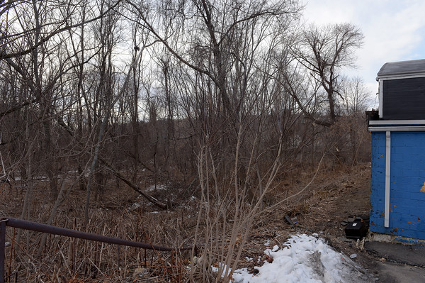 TIM JEAN/Staff photo <br /> <br /> The vacant land behind Skateland thats next to the Bradford train station and the Merrimack River is where the City of Haverhill wants a developer to build high end condominium development.  2/20/20
