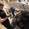 TIM JEAN/Staff photo <br /> <br /> High school senior Dylan Sykes, left, checks the air filter while instructor Joe Like looks on in the Automotive Technology area of Salem high school's CTE center.     2/7/20