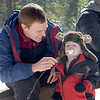 TIM JEAN/Staff photo <br /> <br /> Steve Bell, of Londonderry, helps his son Kenneth, 2, taste a roasted marshmallow during the Annual Musquash Field Day in Londonderry, NH.  2/15/20
