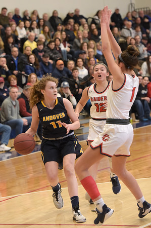 TIM JEAN/Staff photo <br /> <br /> Andover's Amelia Hanscom, left, looks to pass as she is double teamed by Central's Claudia Porto (1) and Adrianna Niles (12) during girls basketball Division 1 North quarterfinals.    2/29/20