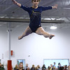 CARL RUSSO/Staff photo The Merrimack Valley Conference Gymnastic League Meet was held Thursday night, February 6th. at A2 Gym and Cheer in Salem NH.  Andover high sophomore, Ksenia Kessler leaps into the air during her balance beam routine. <br /> 2/6/2020