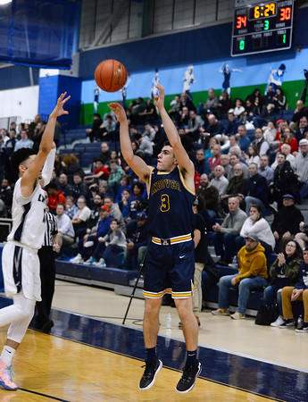 CARL RUSSO/Staff Photo. Andover's Richie Shahtanian takes the three point jump shot. Lawrence defeated  Andover 60-54 in boys Basketball action in the D1 North tournament. 2/25/2020.