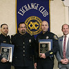 MIKE SPRINGER/Staff photo<br /> Detectives Angel Lopez, left, and Charles Saindon, second from right, receive the Lawrence police officer of the year award from Lawrence Police Chief Roy Vasque, second from left, and Lawrence Exchange Club President Sean Devan, right, during the club's 58th annual Public Safety Night on Wednesday in Andover.<br /> 2/27/2020