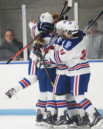 CARL RUSSO/Staff Photo Methuen/Tewksbury's players celebrate after Lydia Pendleton scores the first goal of the game. Methuen/Tewksbury defeated Longmeadow in OT 2-1 girls hockey tournament opener. 2/26/2020.
