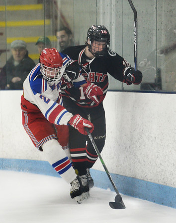 CARL RUSSO/Staff photo North Andover's Thomas Doherty fights for the puck behind Tewksbury's net with Caden Connors. <br /> <br /> North Andover defeated Tewksbury 3-2 in Div. 2 hockey quarterfinals at the Chelmsford Forum Friday night. 2/28/2020
