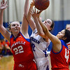 CARL RUSSO/Staff photo Methuen captain, Olivia Barron fights for the rebound. Methuen defeated Somerville 61-47 in girls' basketball action Tuesday night. 2/18/2020..