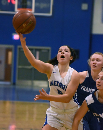 CARL RUSSO/staff photo. Methuen's Stephanie Tardugno fights her way to the basket. Methuen Rangers defeated Framingham in girls' basketball action Sunday afternoon.  2/9/2020.