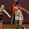 CARL RUSSO/Staff Photo Whittier's Grace Efosa-Aguebor keeps her eye on the ball as she steals it from Winthrop's Polina Bell. Winthrop defeated Whittier Tech. 55-39 in Div. 3 North quarterfinals in girls basketball action Thursday night. 2/27/2020