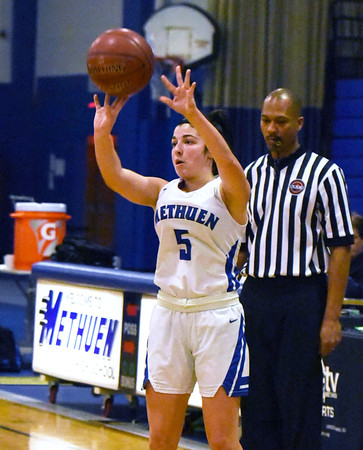 CARL RUSSO/staff photo. Methuen's Stephanie Tardugno takes the three point jump shot. Methuen Rangers defeated Framingham in girls' basketball action Sunday afternoon.  2/9/2020.