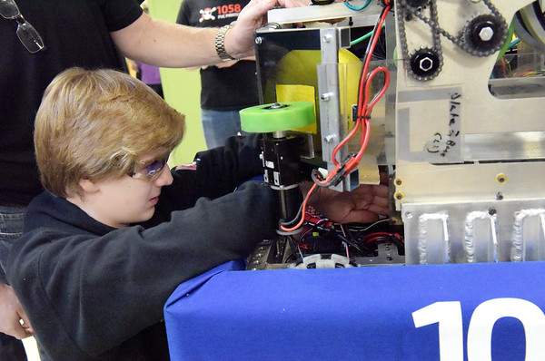 TIM JEAN/Staff photo <br /> <br /> Londonderry's David Jarvis, 15, makes an adjustment on the teams robot in the pit area during the FIRST Robotics New England Granite State District event held at Salem High School.   2/29/20
