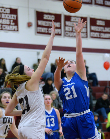 CARL RUSSO/Staff photo Pelham's Lili Rutherford drives to the hoop against Timberlane's Mia Censullo. Pelham defeated Timberlane 52-21 in girls' basketball action Monday night. 2/17/2020.