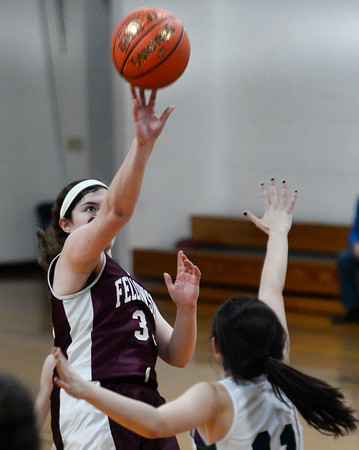 CARL RUSSO/Staff photo Fellowship's Ester Mills takes the jump shot over and PMA's Eva Fabino. Presentation of Mary Academy defeated Felllowship Christian Academy 51-43 in girls' basketball action Tuesday afternoon. 2/04/2020