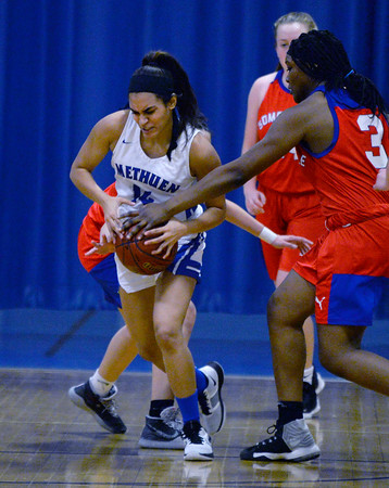 CARL RUSSO/Staff photo Methuen's Yarmilis Vasquez steals the ball out of Somerville player's hands. Methuen defeated Somerville 61-47 in girls' basketball action Tuesday night. 2/18/2020.