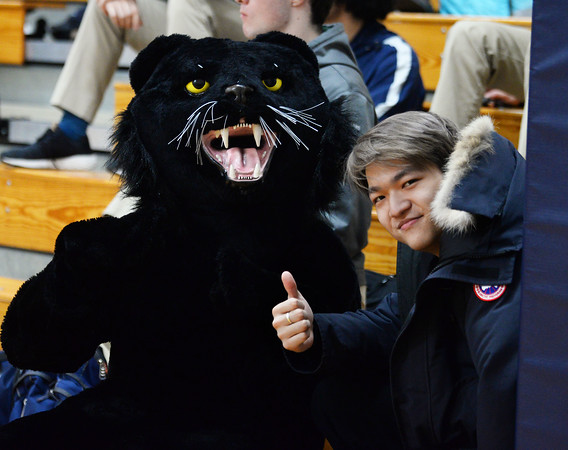 CARL RUSSO/Staff photo PMA's mascot, the Panther and  a fan. Presentation of Mary Academy defeated Felllowship Christian Academy 51-43 in girls' basketball action Tuesday afternoon.  2/04/2020