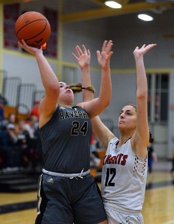 CARL RUSSO/Staff photo Haverhill's Haley Phillips drives to the basket against North Andover's Elle Dadiego. Haverhill defeated North Andover 52-47 in girls' basketball action. 2/7/2020.