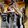 CARL RUSSO/Staff photo Fellowship's Merrie Black, right, battles for the rebound with PMA's Connie Chong, 25 and Eva Fabino. Presentation of Mary Academy defeated Felllowship Christian Academy 51-43 in girls' basketball action Tuesday afternoon. 2/04/2020