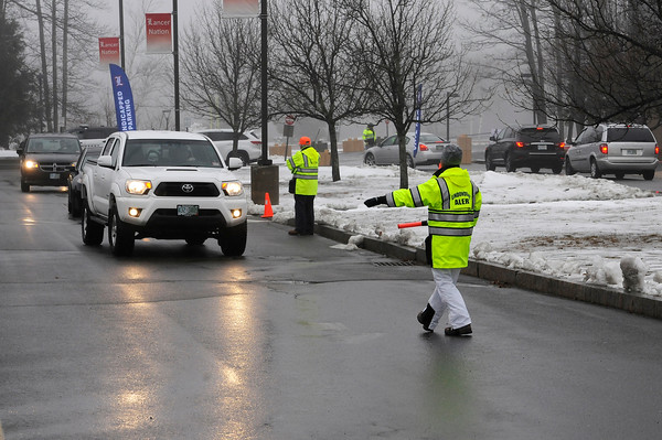 TIM JEAN/Staff photo <br /> <br /> Londonderry's ALERT team members direct vehicles to park before voting at the Londonderry High School during the New Hampshire primary.     2/11/20