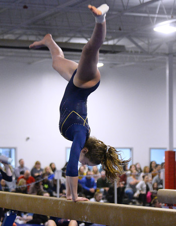CARL RUSSO/Staff photo The Merrimack Valley Conference Gymnastic League Meet was held Thursday night, February 6th. at A2 Gym and Cheer in Salem NH.  Andover high junior Amanda Morin performs on the    balance beam during the meet.<br /> <br /> Team Score: Chelmsford/Billerica/Tyngsboro 141.45, 2. Central Catholic 139.70, 3. North Andover 138.35, 4. Methuen 137.7, 5. Haverhill 136.85, 6. Andover 132.15, 7. Lowell 130.65, 8. Dracut 130.40, 9. Tewksbury 128.95<br />  2/6/2020
