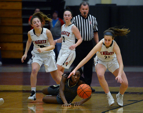 "CARL RUSSO/Staff photo North Andover's Jackie Rogers steals the ball from Haverhill""s Leandra Kwo. Haverhill defeated North Andover 52-47 in girls' basketball action. 2/7/2020."