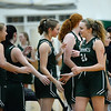CARL RUSSO/Staff Photo. On February 26, Brooks School defeated St. Mark's 81-25 in girls basketball action during senior night.  Senior Brooke Cordes, right of North Andover congratulates her teammates on the victory. 2/26/2020.