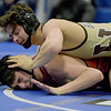 TIM JEAN/Staff photo <br /> <br /> Haverhill's Jake Nicolosi, top, takes on Newton South's Phillip Amitan in the 145 pound match during the MIAA Division 1 wrestling finals at Methuen High School.    2/22/20