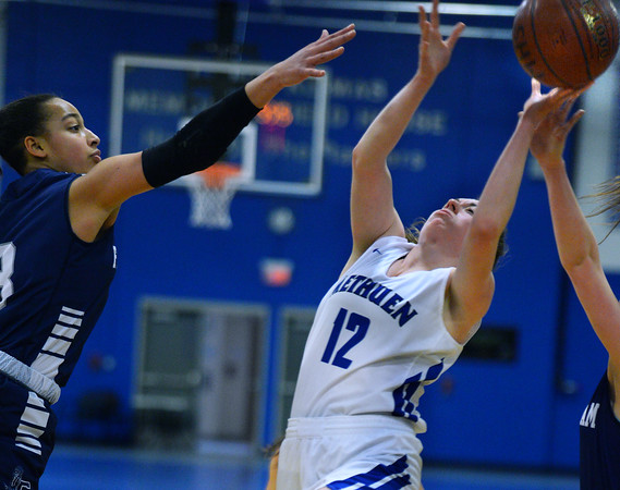 CARL RUSSO/staff photo. Methuen captain, Olivia Barron fights her way to the basket. Methuen Rangers defeated Framingham in girls' basketball action Sunday afternoon.  2/9/2020.