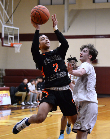 CARL RUSSO/Staff photo Greater Lawrence's Jeremiah Mejia sails to the basket against Whittier's Colin McGonagle. Greater Lawrence Tech. defeated Whittier Tech. 53-42 in boys' basketball action. 2/03/2020
