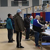 TIM JEAN/Staff photo <br /> <br /> Derry residents wait in line to pickup ballots before voting at the Gilbert H. Hood Middle School during the New Hampshire primary.     2/11/20
