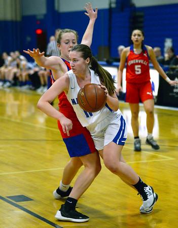 CARL RUSSO/Staff photo Methuen's Megan Melia maneuvers around Somerville defender towards the basket. Methuen defeated Somerville 61-47 in girls' basketball action Tuesday night. 2/18/2020